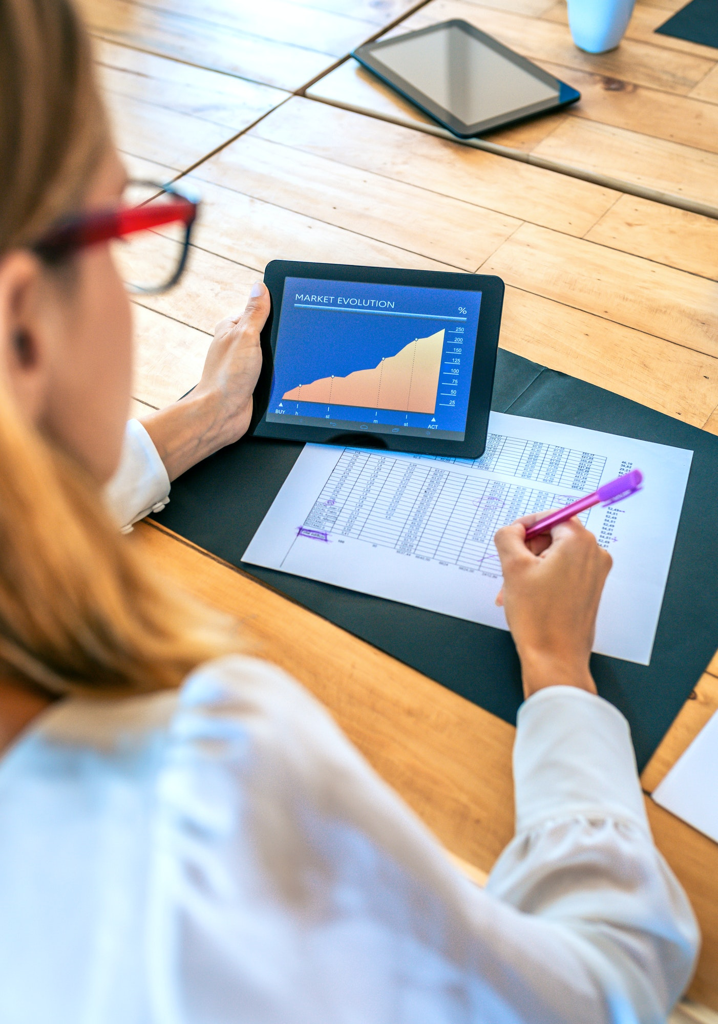 Businesswoman analyzing market evolution with tablet